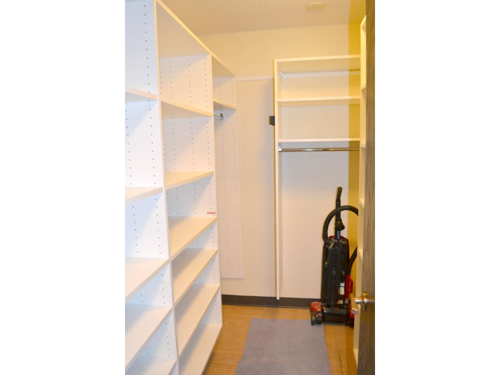 In the front entry is a spacious walk-in closet with custom shelving.