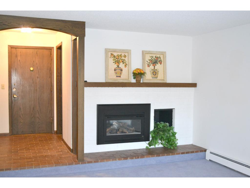 A gracious entry and a gas fireplace in theliving room...