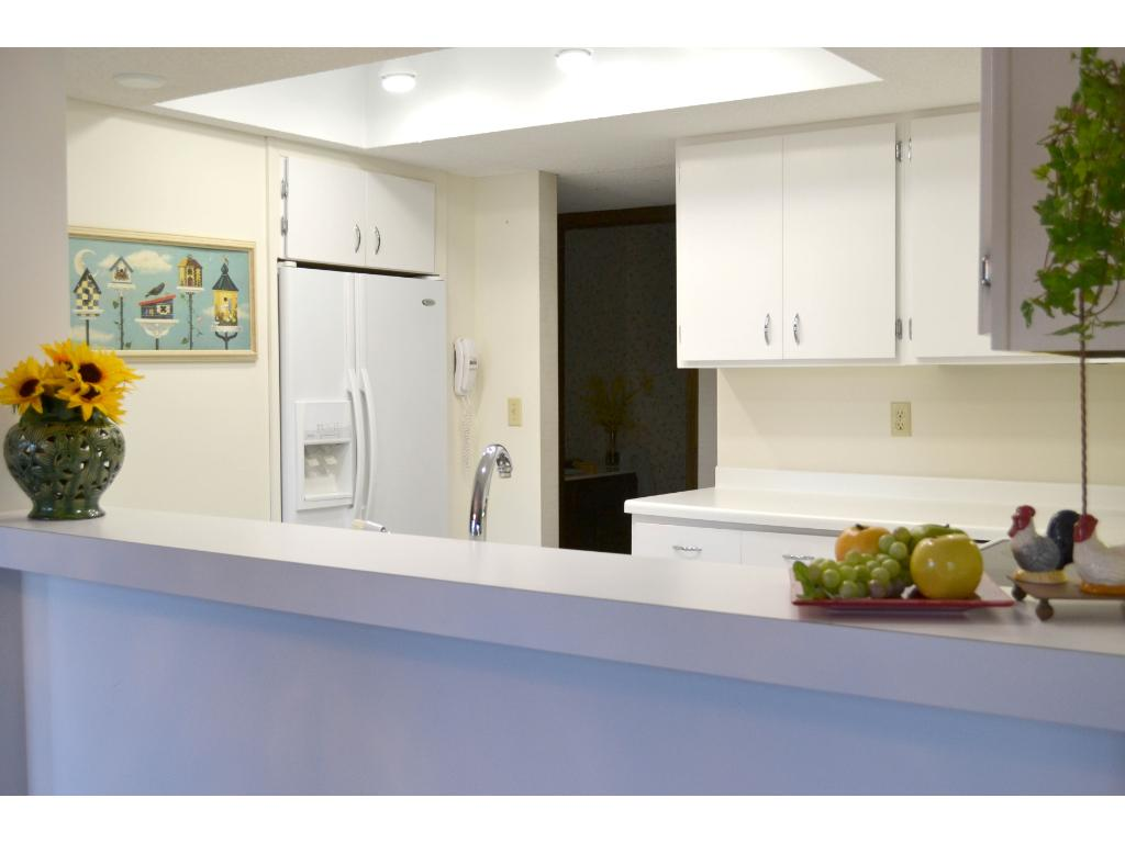 Entertain with ease as the kitchen opens to the informal dining area.