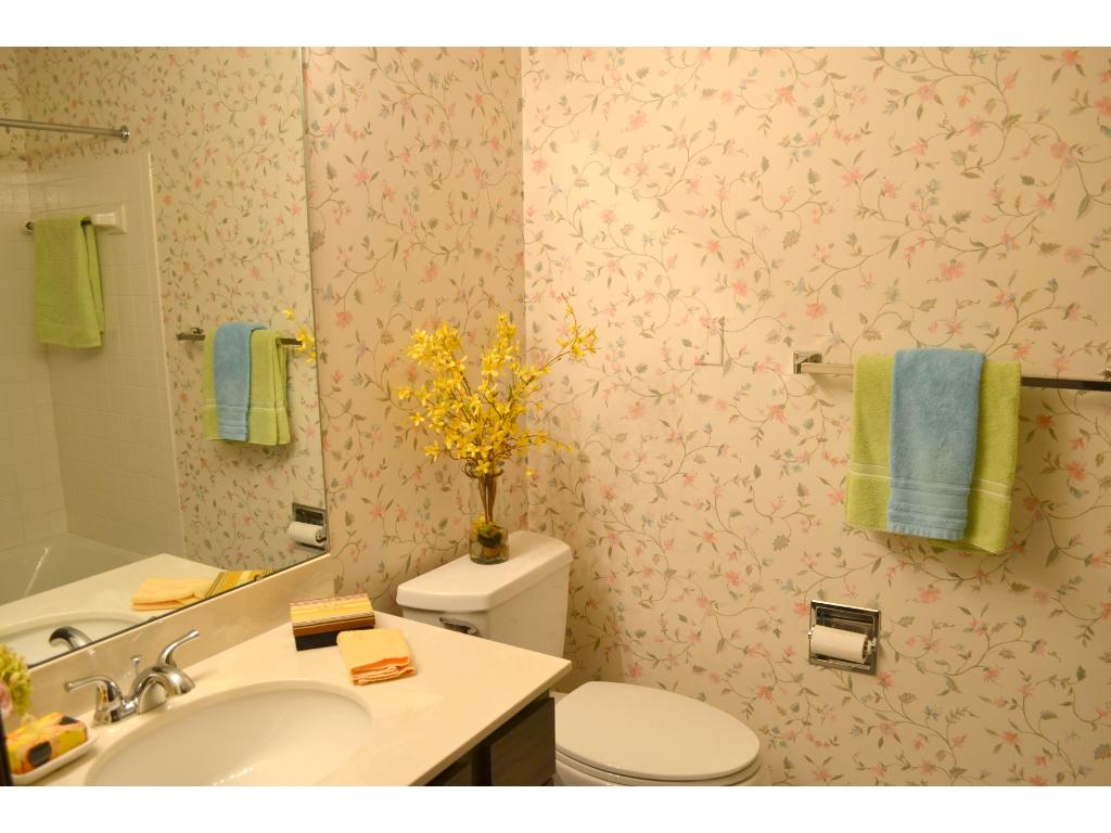 Main bath is conveniently located near the kitchen and the laundry area.