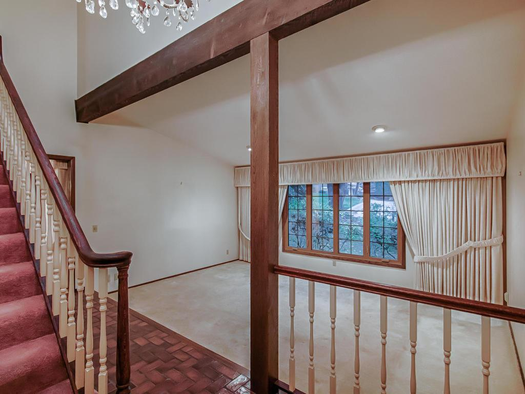 Grand entry way with soaring vaulted ceilings