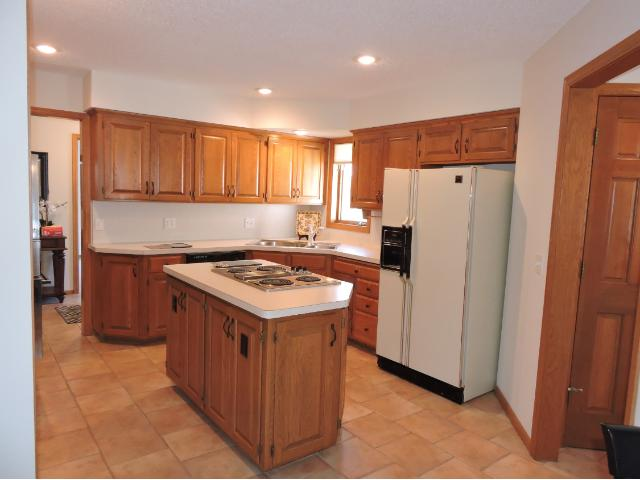 Center island kitchen. First floor laundry offers great opportunity for one level living.