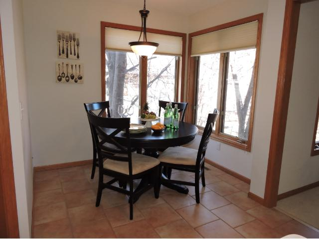 Kitchen also has a room for a dining table.