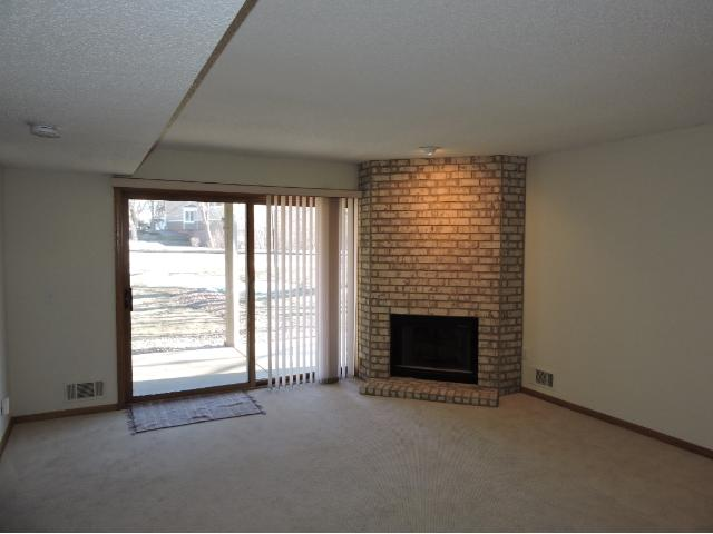 Walk out lower level to patio. Another wood burning fireplace. Two more bedrooms and a full bath.