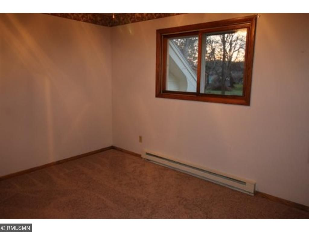 The main floor full bath has lots of counter space, cabinetry and a very large tiled shower.