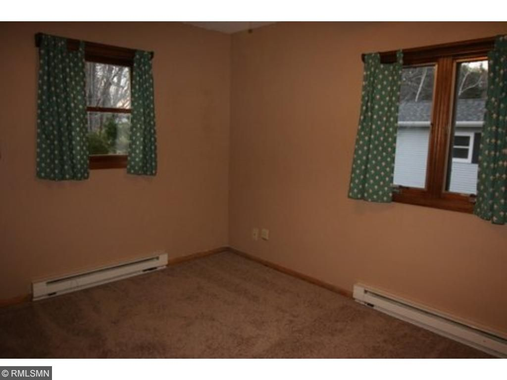 Spare bedroom looks out to the back yard.