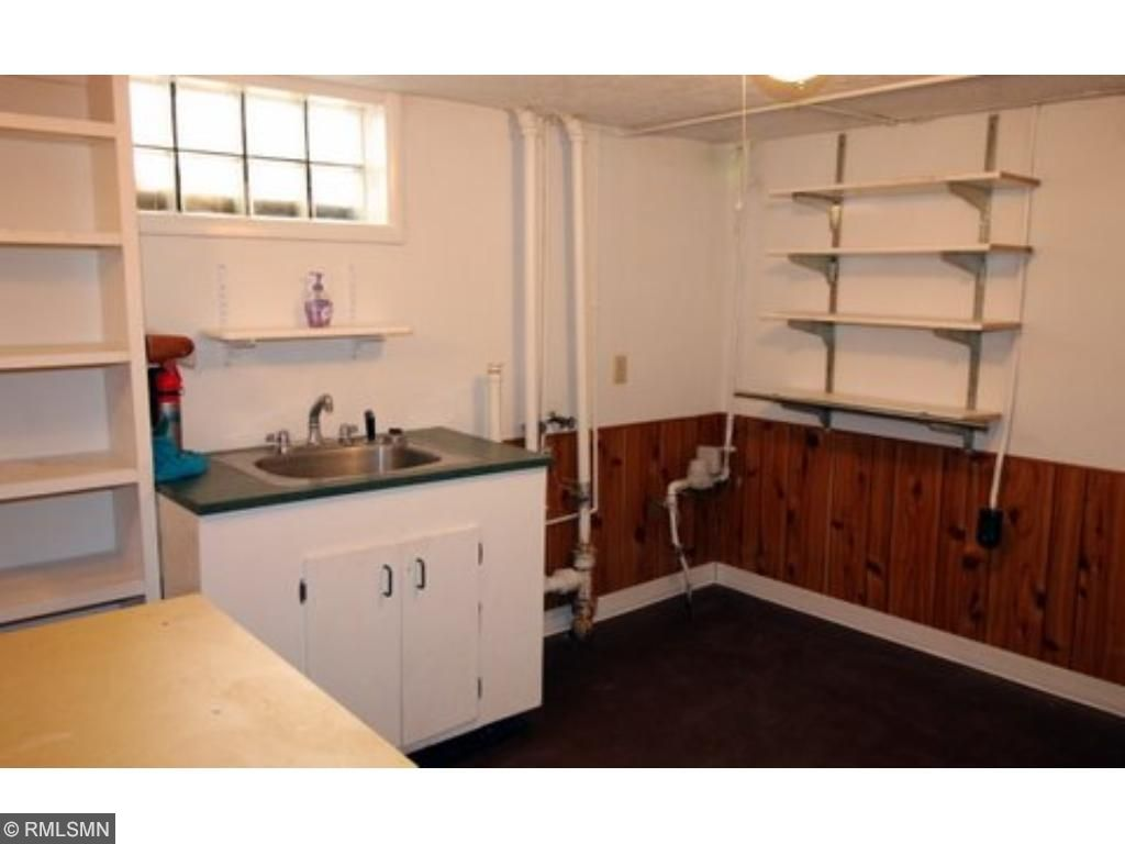 The utility room is spacious and bright.  There is a washer/dryer hookup here so that you could located the laundry room downstairs if you so chose.