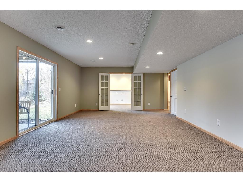 Basement with french doors to office or 5th bedroom.