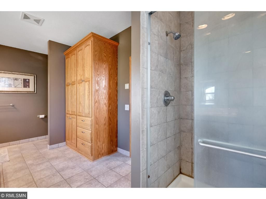 Master Bath with 2 sinks, tub and shower.