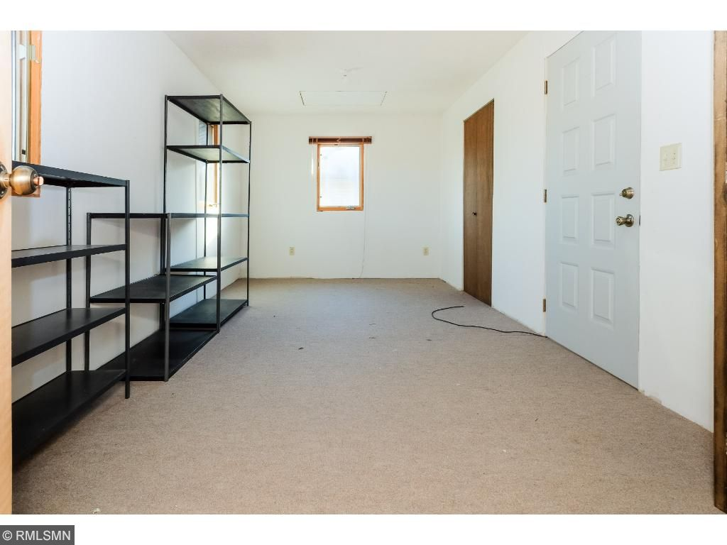 Large finished storage area access from pull down staircase in garage or access from master bedroom