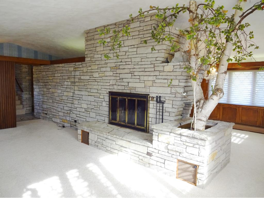 Impressive stone wall wood burning fireplace perfect for first seasons snowfall.