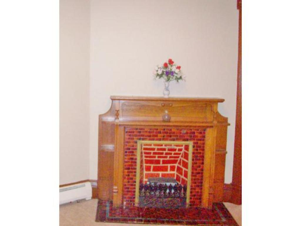 Main level decorative-only fireplace in the front living room.