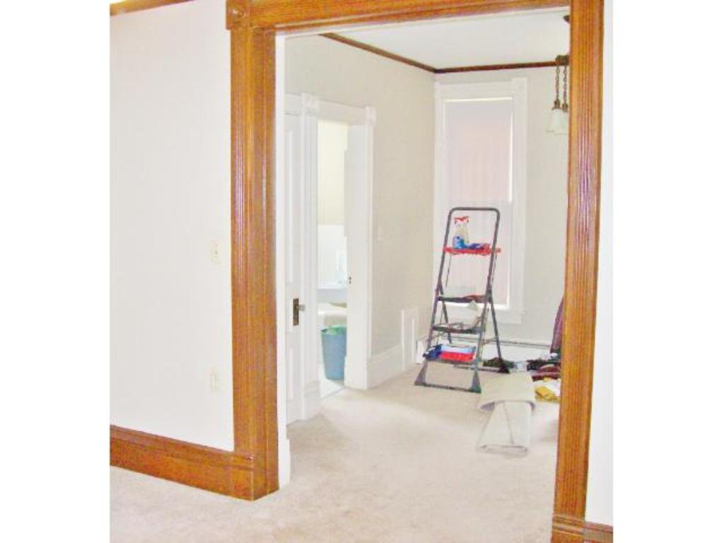 Picture is from the main level dining room showing a den/office area and where the main level bathroom is located.