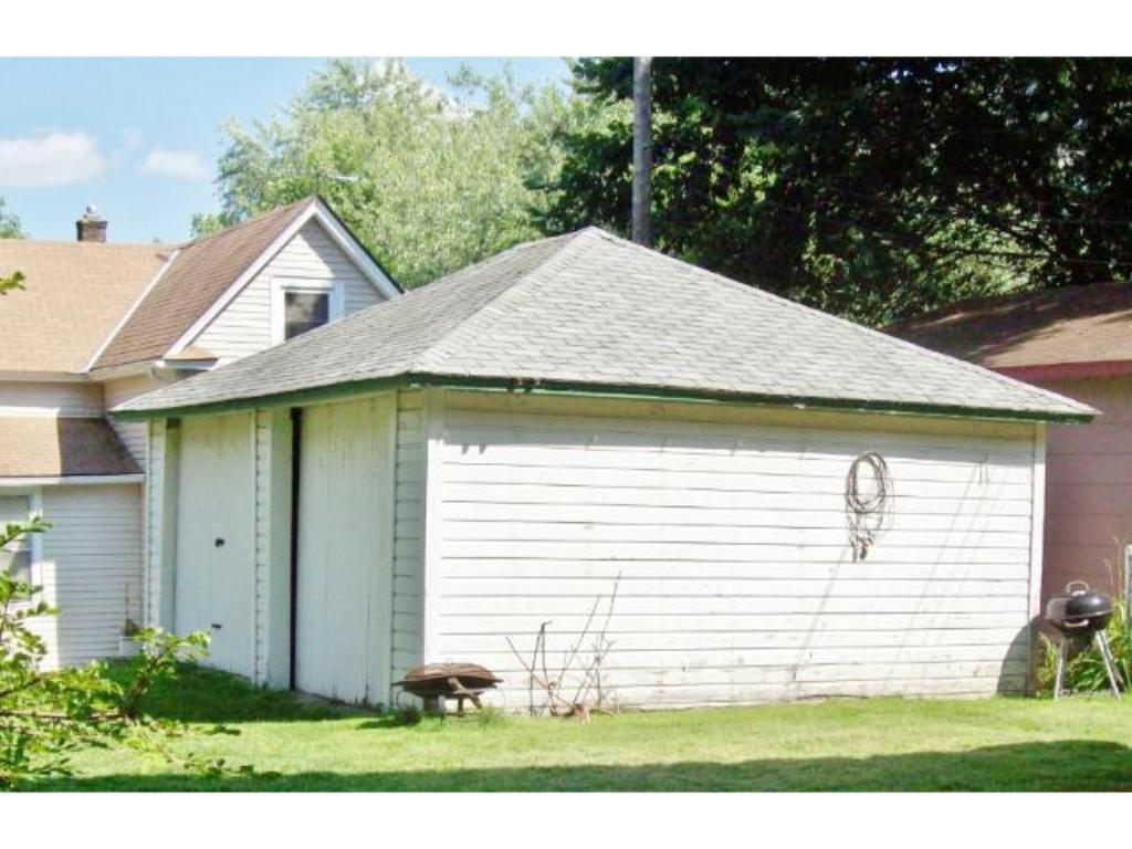 Old two car garage is primarily used for storage.