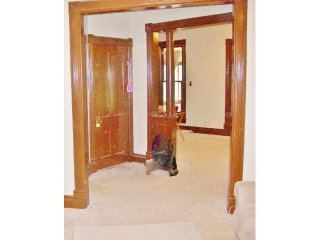 Upper level entry area. Terrific woodwork!