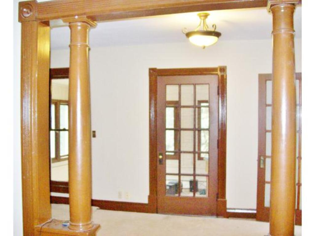Second level front living room with entry to the enclosed porch.