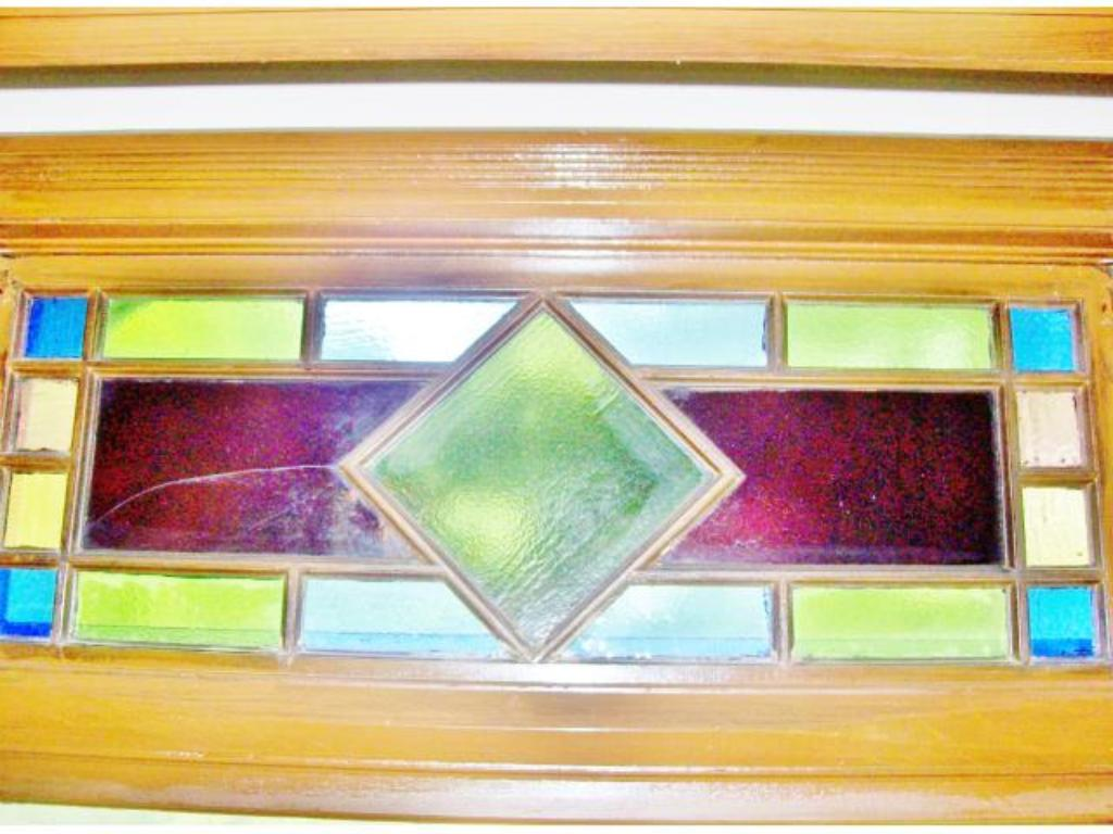 Vintage stained glass over entry to the 2nd level sun room.