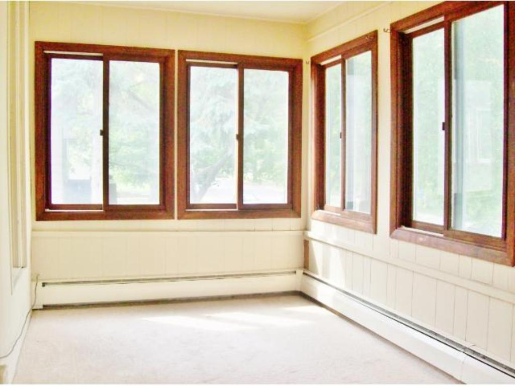 2nd level porch is fully enclosed and has baseboard heat. Perfect guest bedroom area!
