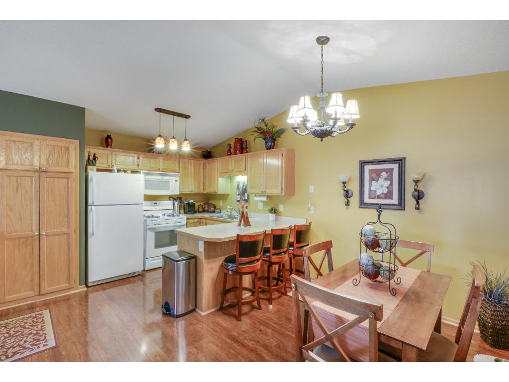 Upper level dining/kitchen with vaulted ceilings for light & airy open feel! Eat-in area in the kitchen for extra dining space!