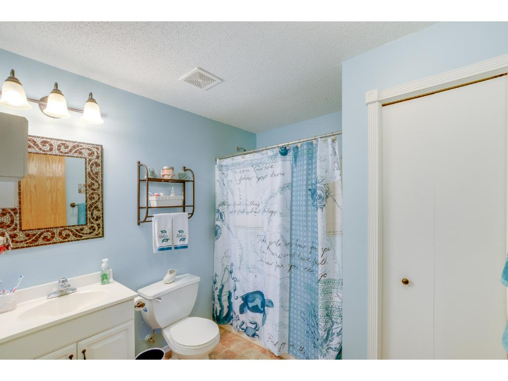Lower level bathroom with a full tub/shower and linen closet!