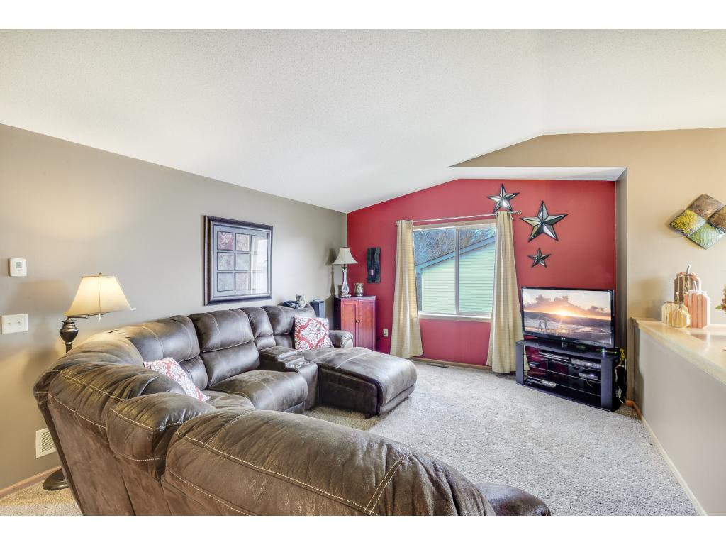 Upper level living room with vaulted ceilings and great natural light!