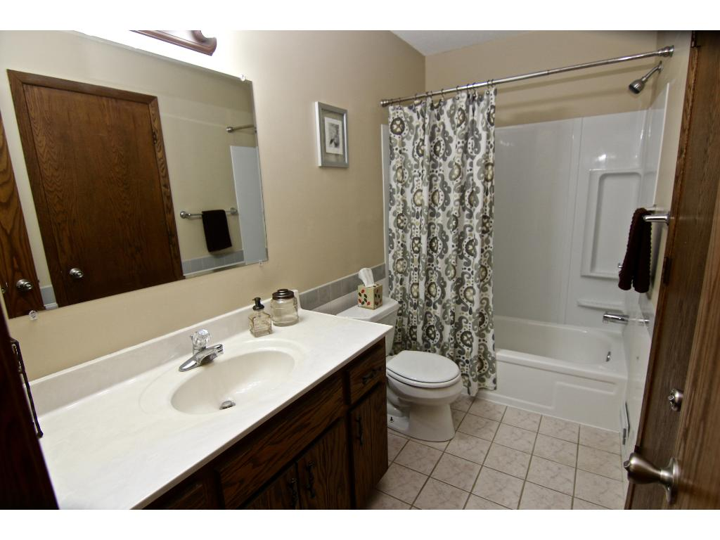 Walk-through bathroom with access to master bedroom and main hallway.