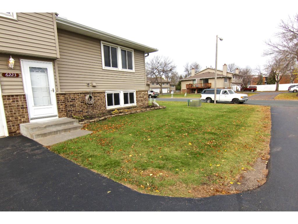 This unit has a nice yard space, as well as area along foundation for a small garden/perennials.