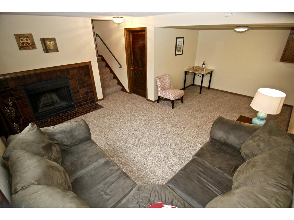 Another view of the family room with fireplace on the left & door leading to utility/laundry room.