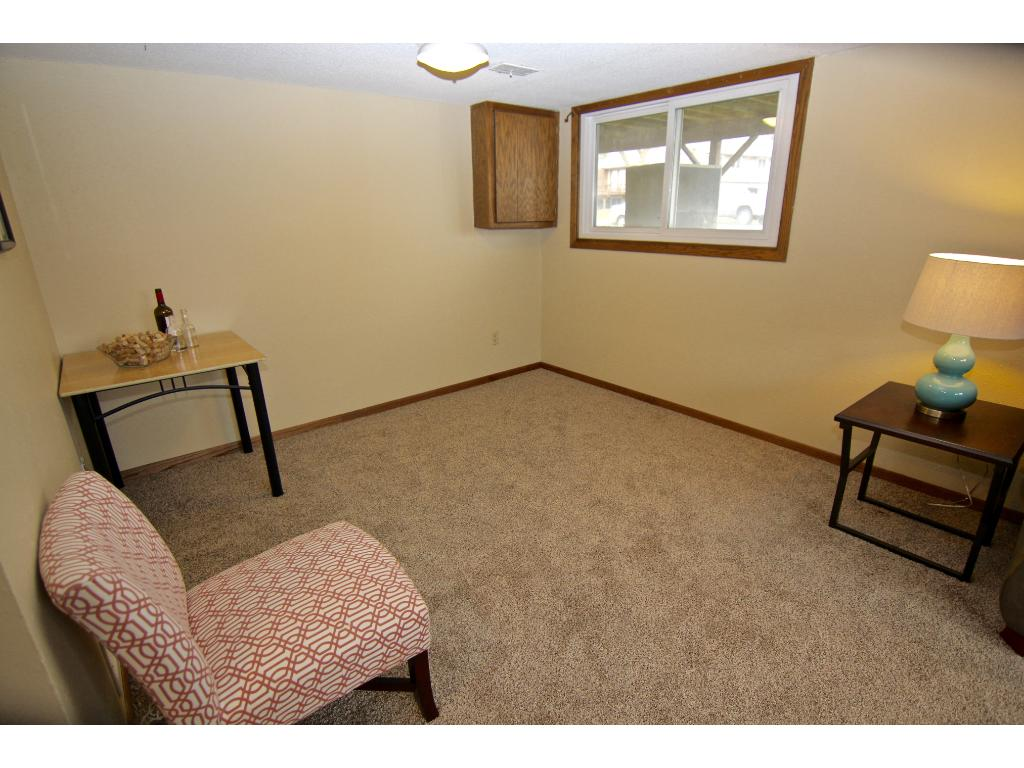 This bonus space off the family room will make a wonderful exercise area, bar/entertaining space, office nook...bring your ideas!