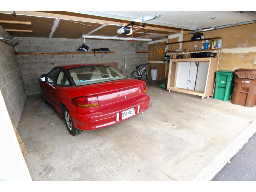 Large garage, with room for two cars & additional toys, bikes & storage.
