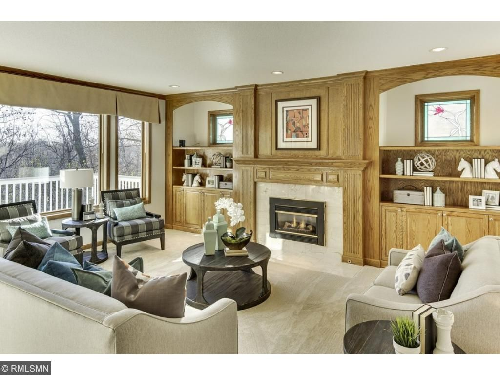 Notice the gorgeous built-in cabinets and FP surround as well as the charming stained glass windows!