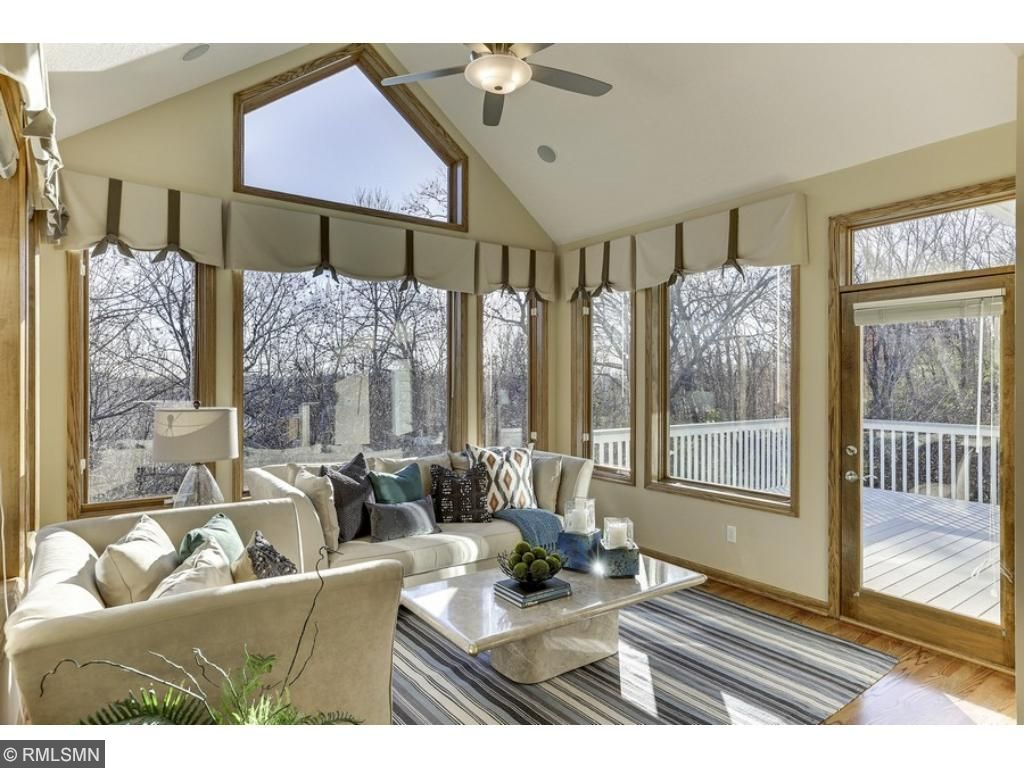 Rest and relax in the wonderful sunroom - with access to the new deck!