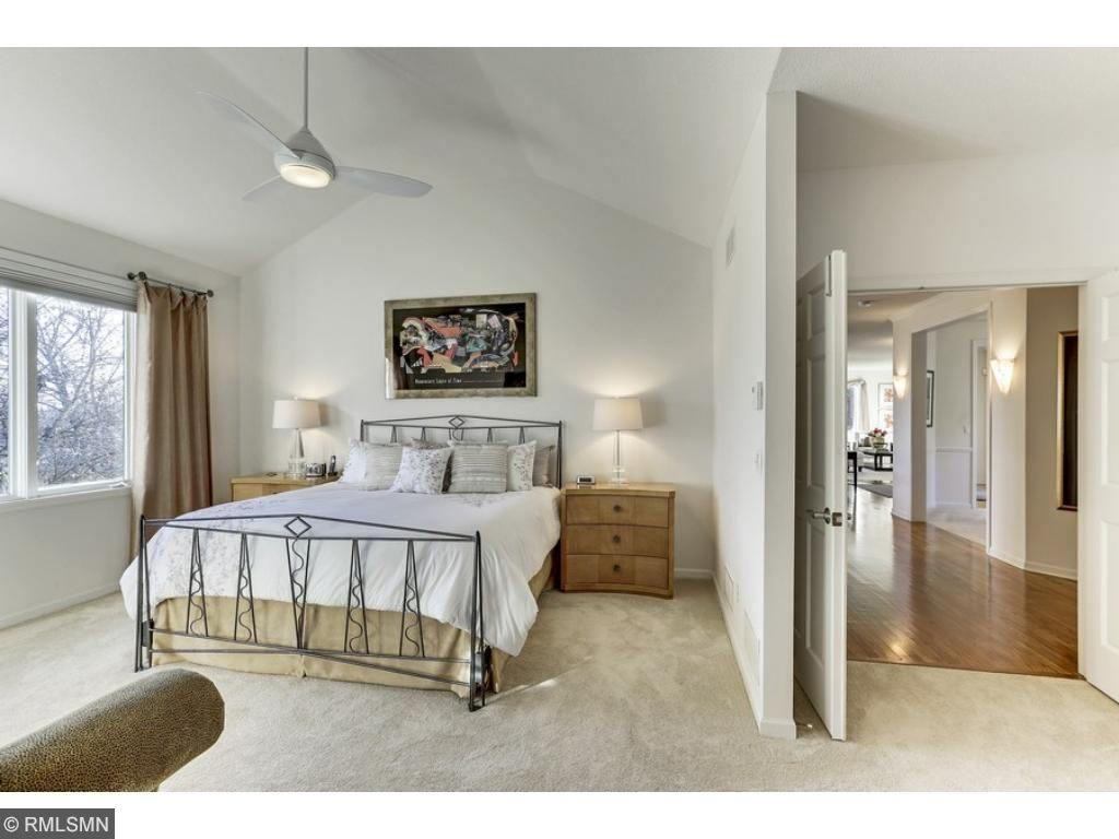 Your own private oasis awaits! Main level Master suite with vaulted ceiling and views of the backyard!