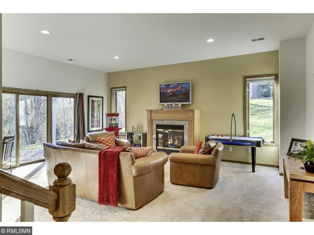 The finished lower level walk-out is complete with 2nd family room - a perfect teen hangout or entertaining space!