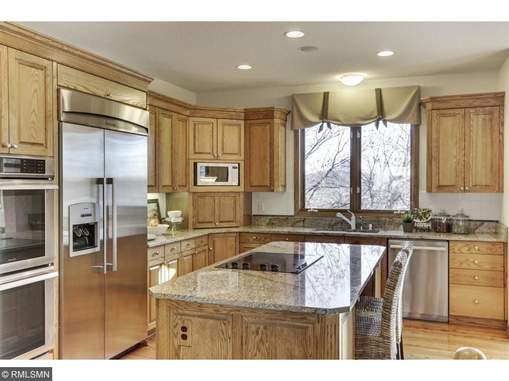 Beautiful granite, high-end stainless appliances, plenty of natural light and refinished hardwood floors.