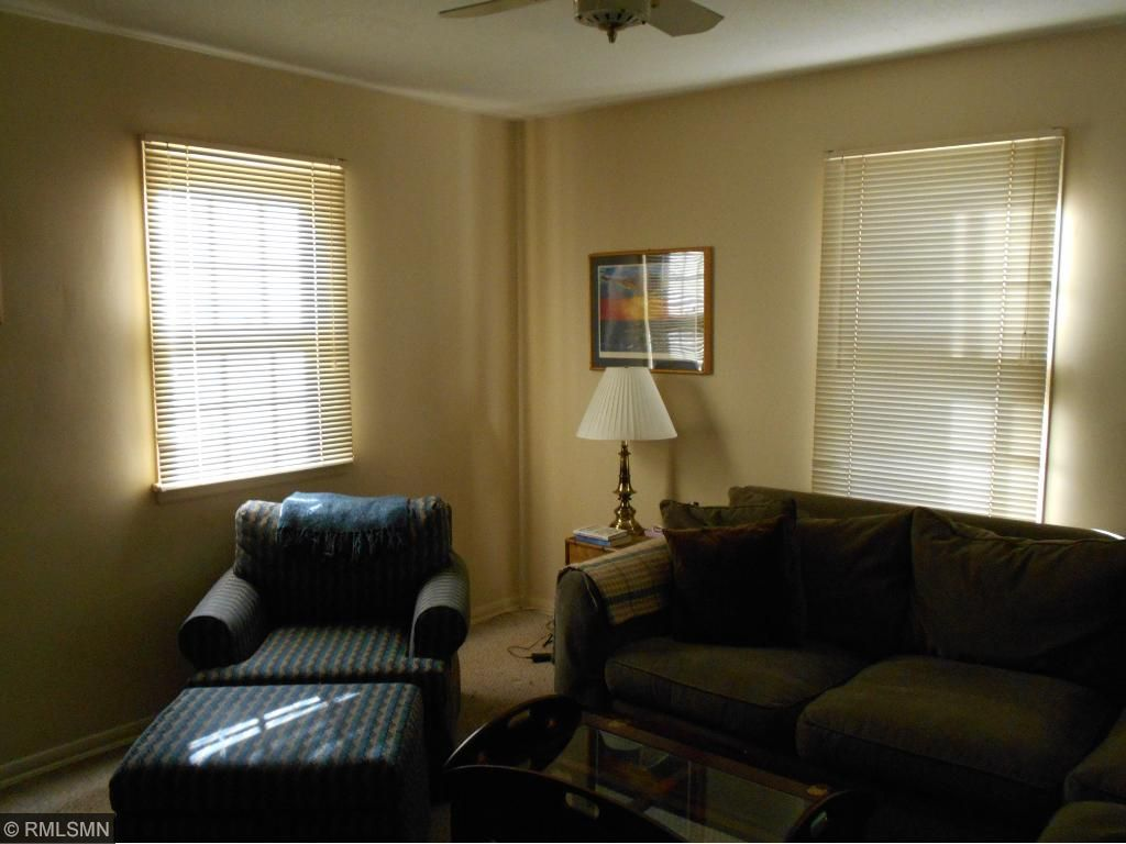 Open staircase to second floor with 3 bedrooms on upper level.