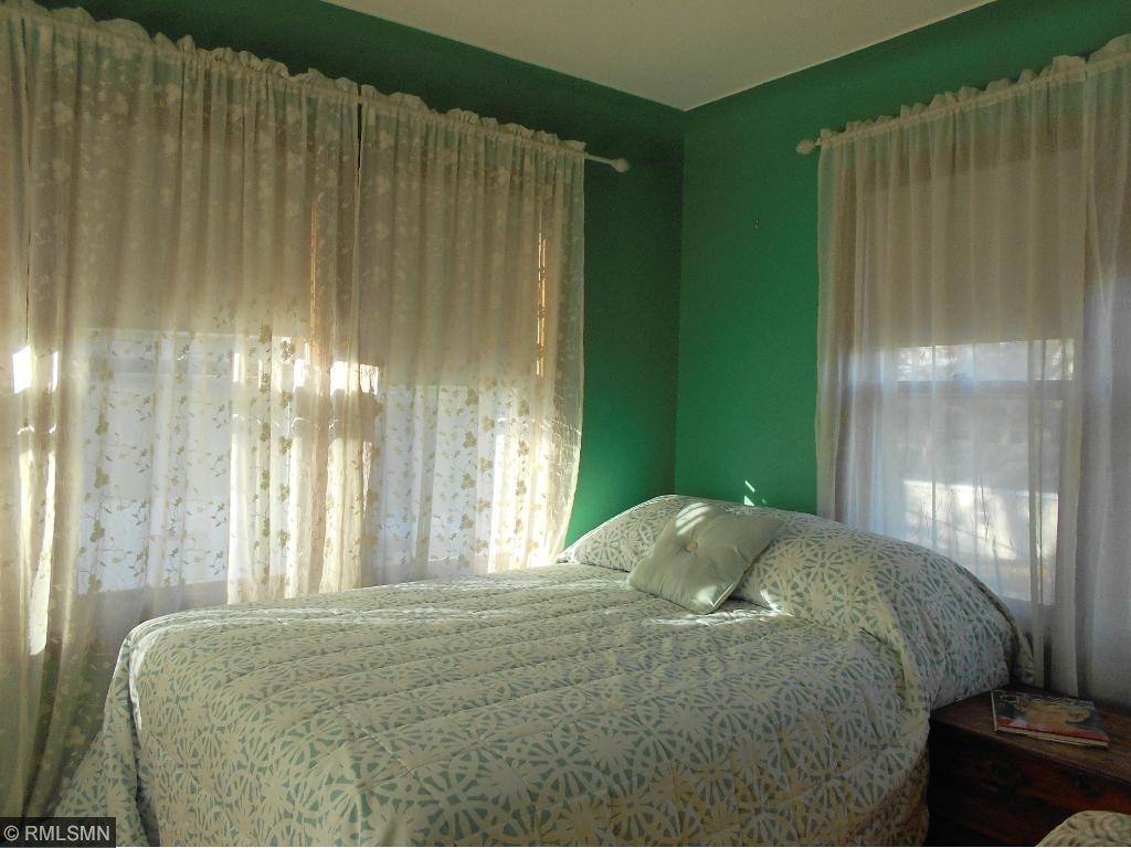 Third bedroom with large windows overlooking backyard.