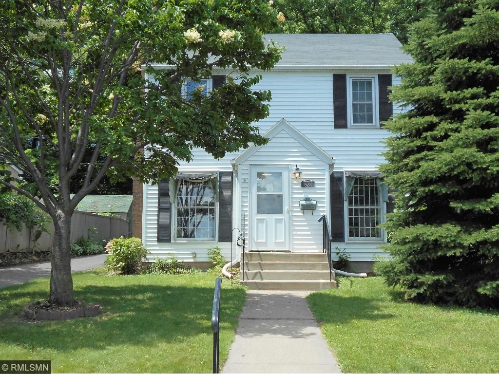 2 Story Colonial with side driveway to garage and backyard.