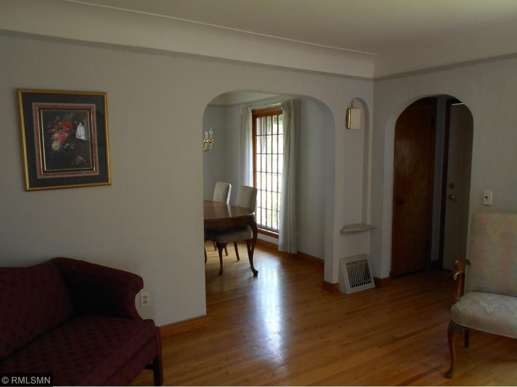 Front entry vestibule with period charm archways.