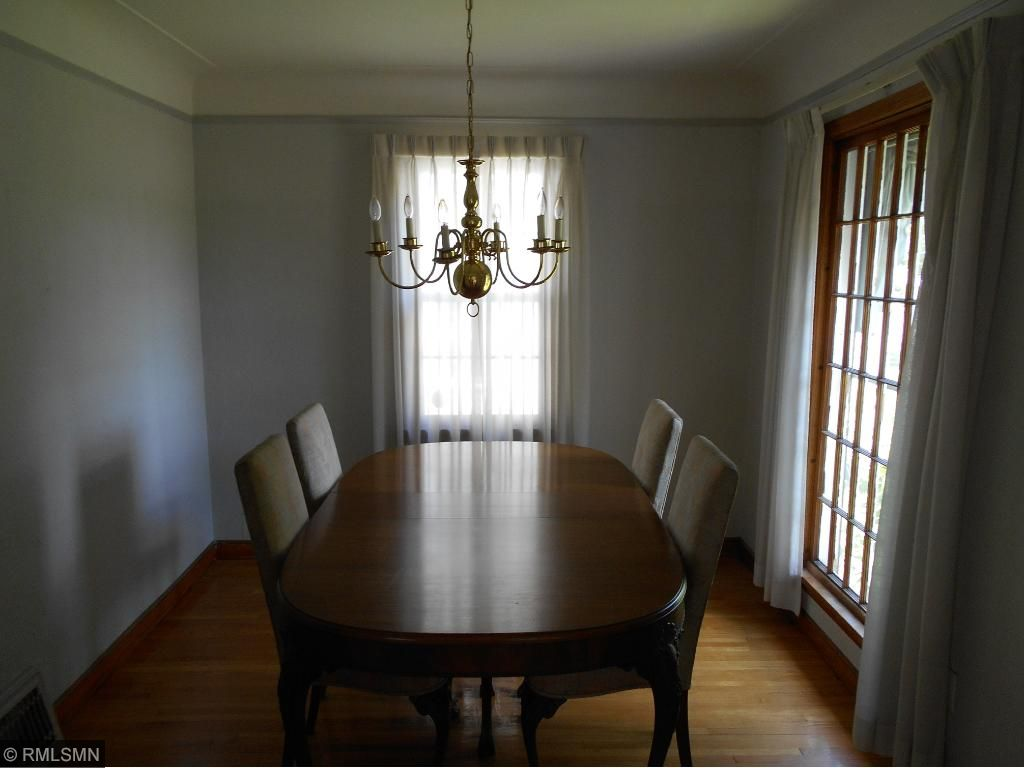 Formal Dining Room with cove ceilings, corner built-in and hardwood floors.