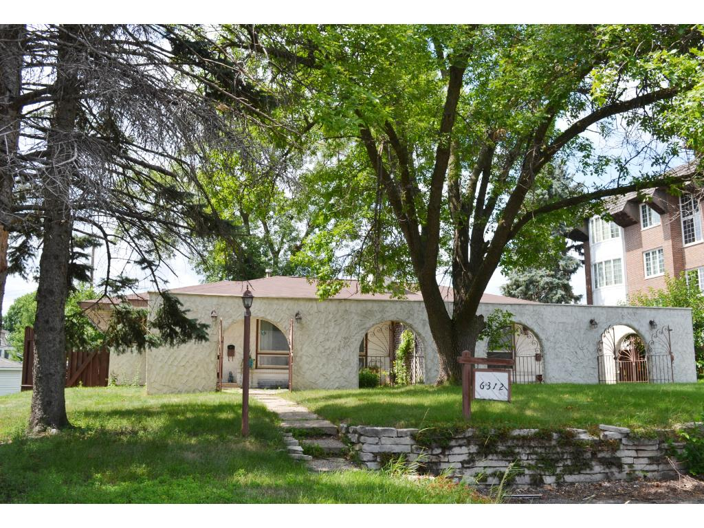 Unique mission style stucco twin home conveniently located near Southdale