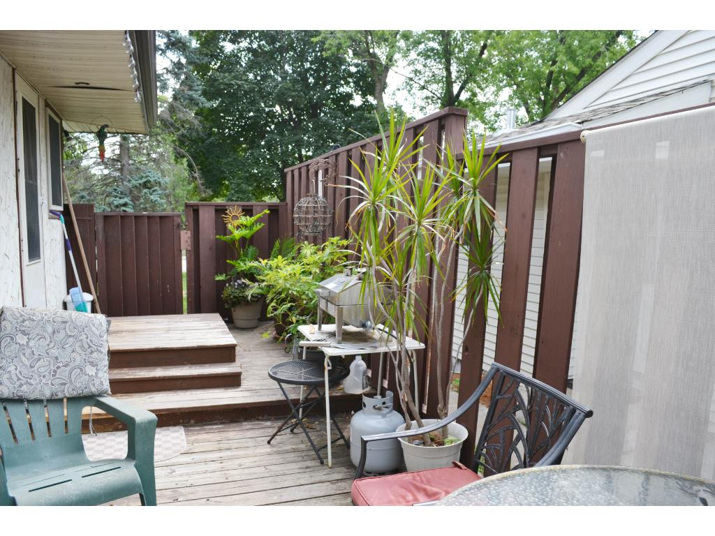 Privacy fenced deck on south side is a perfect spot for grilling outdoor meals and relaxing
