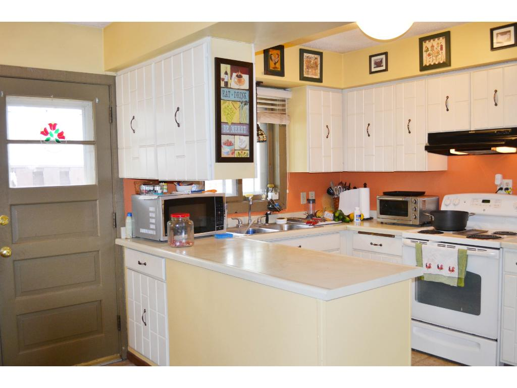 Light kitchen with generous counter space & easy access to deck & back yard