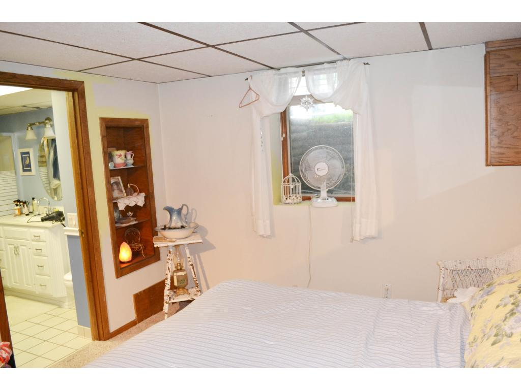 Bedroom in lower level has egress window - note adjacent bath