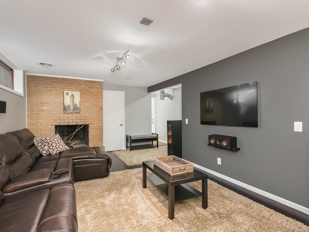 Brick wall fireplace and smooth ceiling.