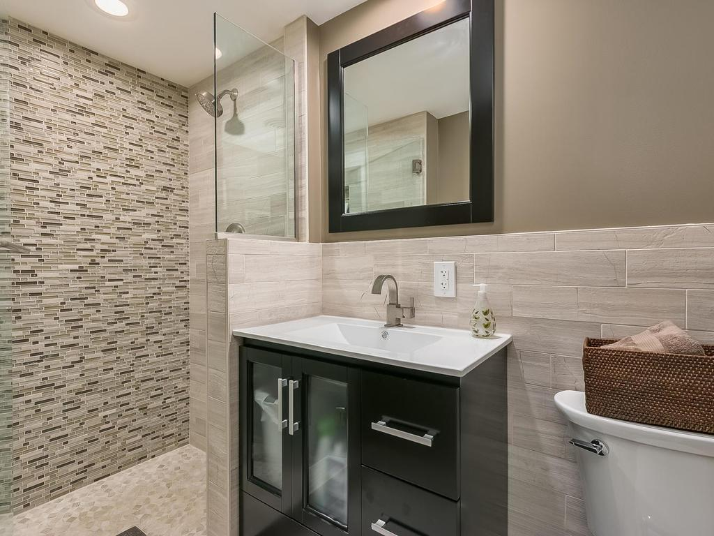 Beautiful 3/4 tile surround step-in shower lower level bath.