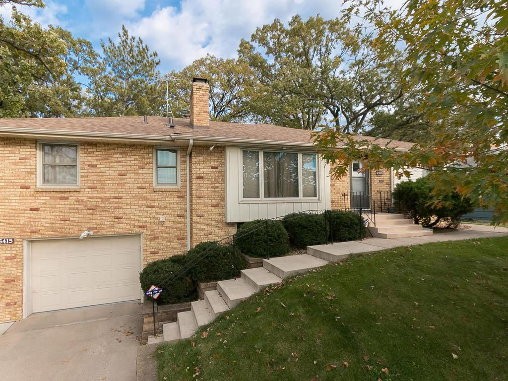 Lovely landscaping and beautiful brick-surround on this updated one story home.