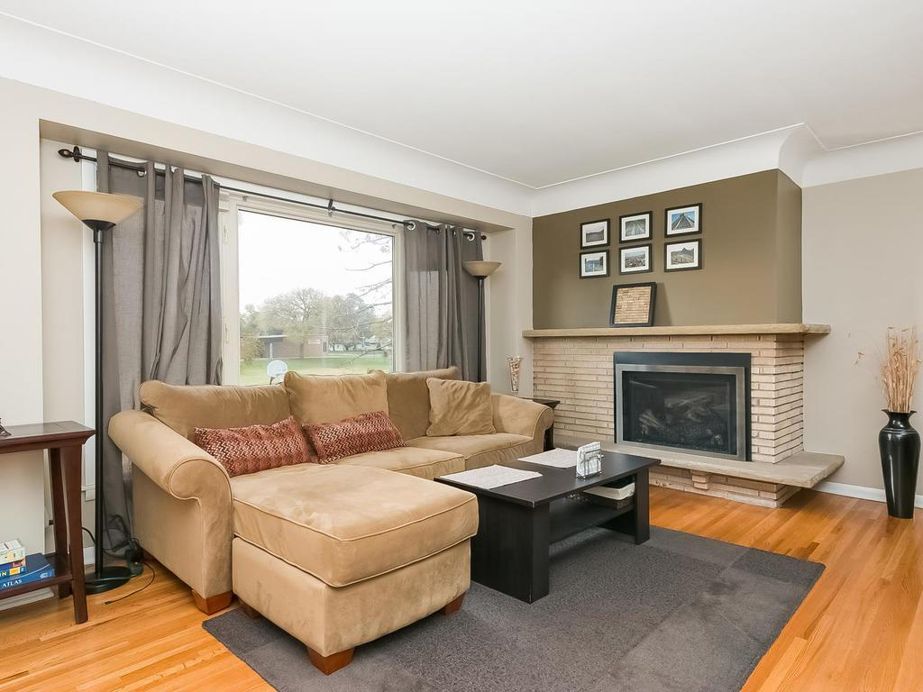 Charming hardwood floors, cove ceiling and stone gas fireplace.