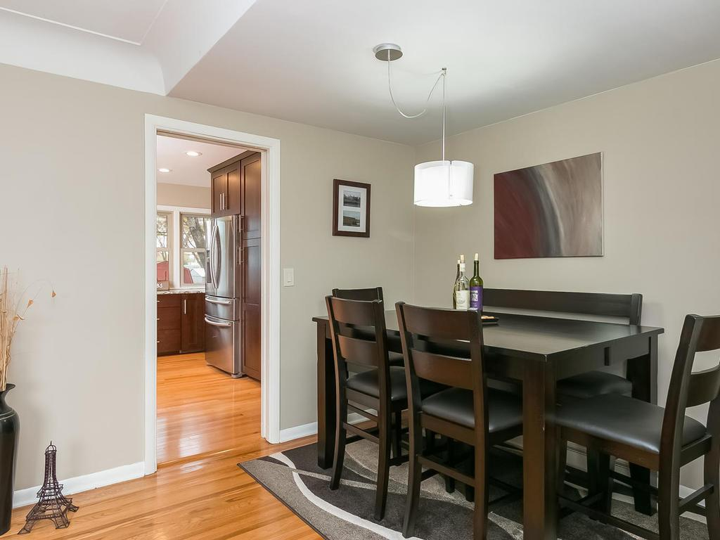 Informal dining leads to spacious kitchen.