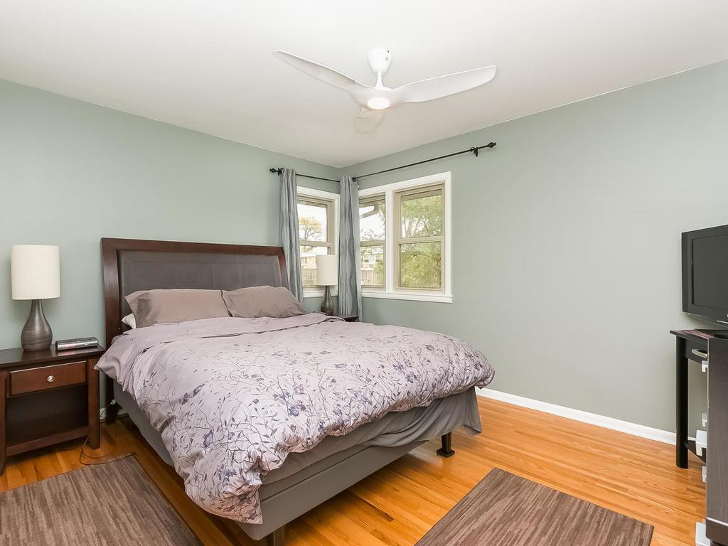 Freshly painted, updated lighting/ceiling fans throughout. One of four bedrooms up.